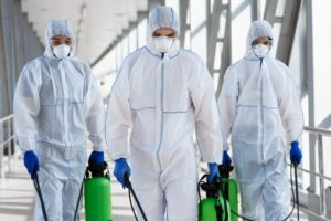 Medical workers making disinfection of public places